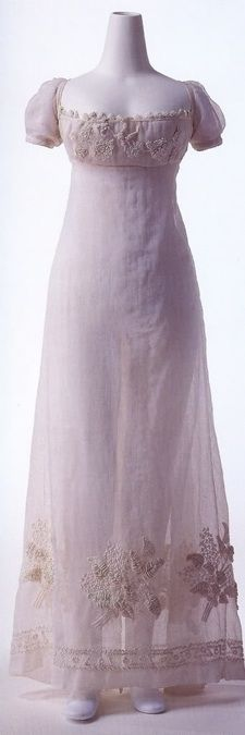 c 1800 White cotton gauze dress embroidered with bouquet pattern at bodice front and hem.