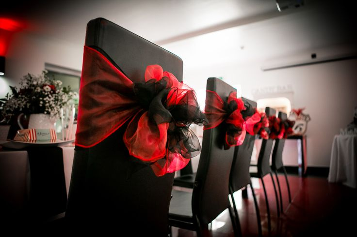 1950's Vintage Rock a Billy Wedding, Wedding Planner Bristol, http://www.mulberryweddingsandevents.co.uk http://www.danielsprackmanphotography.co.uk - The Park Hotel Falfield. Red and white wedding theme. Red and Black wedding theme, Retro diner party theme. Cocktail bar wedding. Wedding chair decoration, Organza Sash, Wedding chair bow.