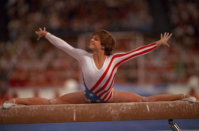 USA's Mary Lou Retton does a split on the beam during the 1984 Summer Olympics. Retton would go onto win five medals, including one gold, during the '84 games. (Andy Hayt/SI) GALLERY: SI's Best Summer Olympic Covers