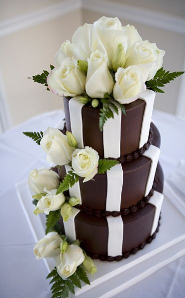 Fresh white roses embellish this simply striped elegant cake. #AUIFineFoods #ChocolateCakes