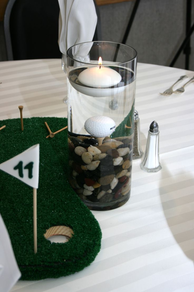 Golf Centerpiece with Ball on Tee in Glass with Floating Candle next to Miniature Golf Course