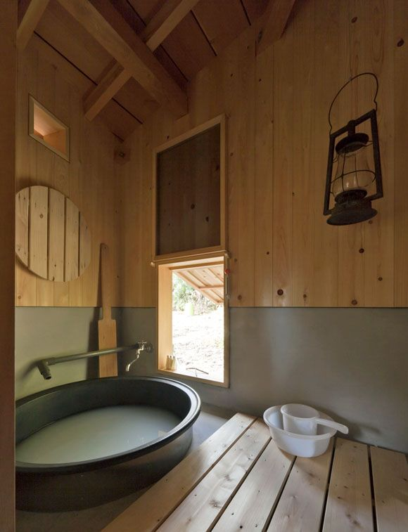 Lemm Hut  by Yoshifumi Nakamura: The architect designed this small hut in the rural area in Nagano as his weekend house. The self-sustaining hut has a bath house with goemon-style tub. The water in this cast-iron tub is directly heated by a fire below. Since the bottom of the tub is very hot, the bather would sit on a wooden deck, which hangs on the wall in the above photo.