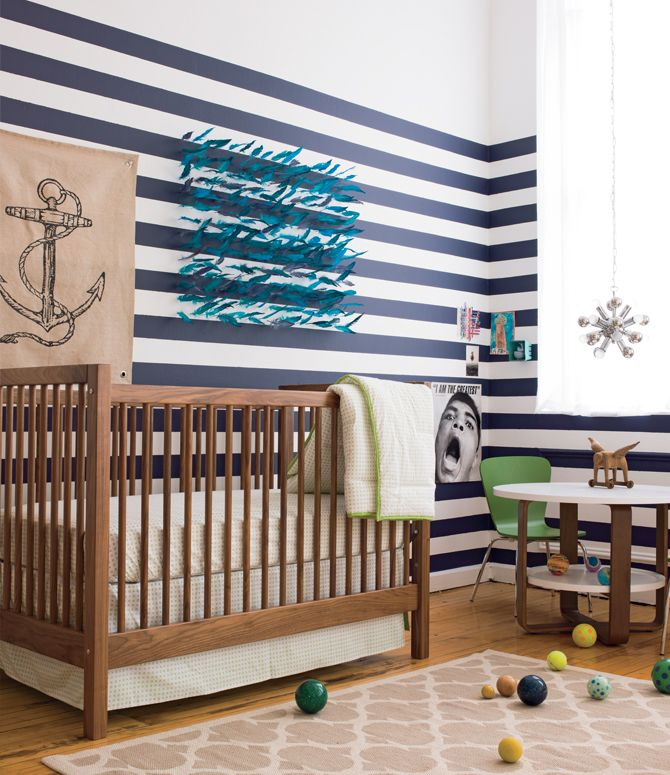 Nautical nursery with feather wall art