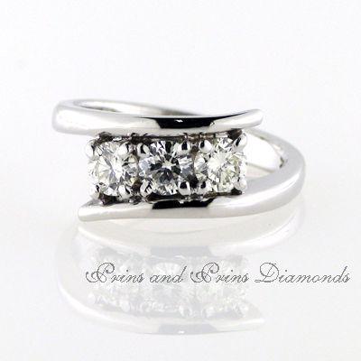Three round brilliant cut diamonds.