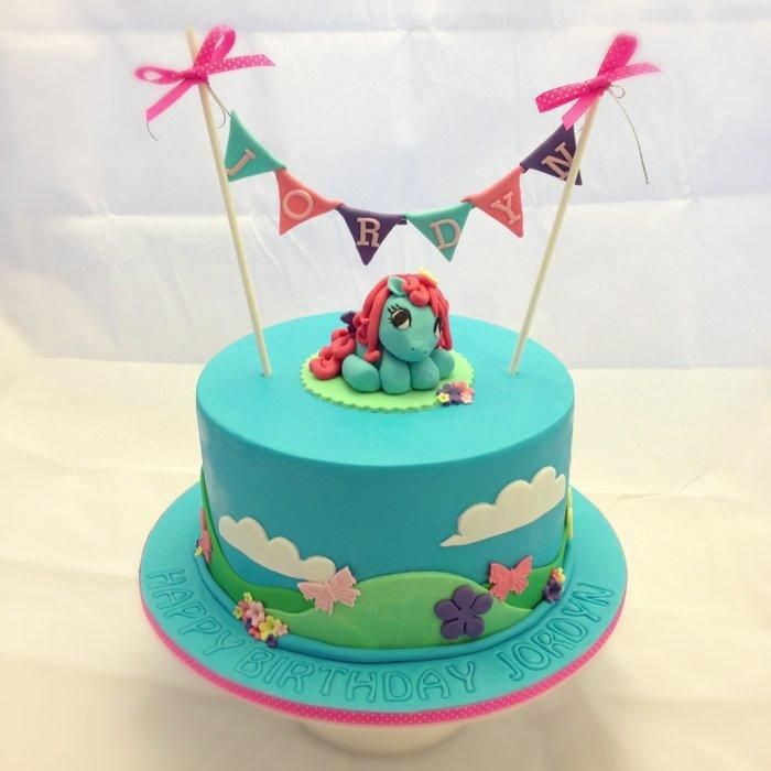 My Little Pony cake in bright blues, purples and pinks. Cake is rainbow swirl inside!