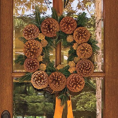 Pinecone Wreath | Welcome guests with this simple, yet festive Christmas wreath. Hang the wreath with wide satin ribbon, and add a bow for a pop of color.