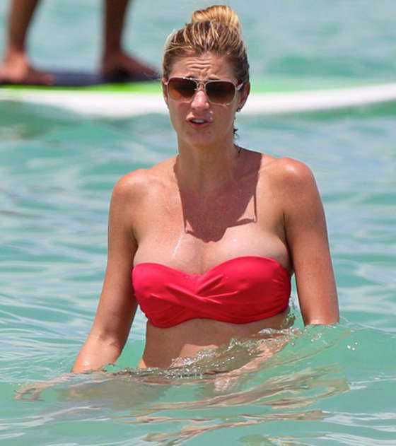 FOX sideline reporter, Erin Andrews shows off her new breast implants and her sizzling body in a Miami Beach bikini. Description from examiner.com. I searched for this on bing.com/images