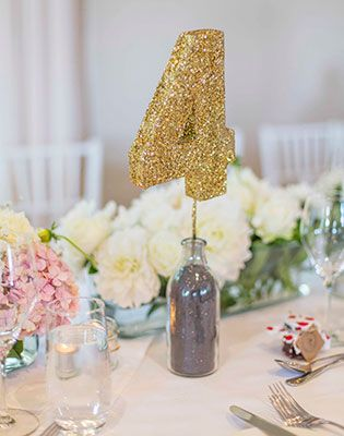 Glittered table numbers: Image: Mint Photography