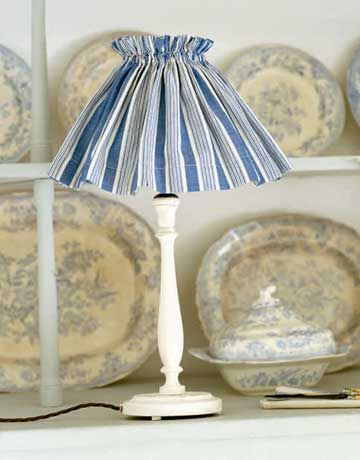Cover a lampshade with fabric to create a unique look