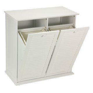 The tilt-out cabinet laundry sorter by Household Essentials will complement your transitional styled home nicely. It has a crisp with finish and shutter front doors to complete the casual and clean lo