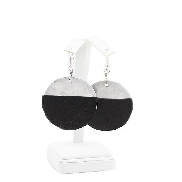 Handmade circle pendant earrings from Gonaives, Haiti.