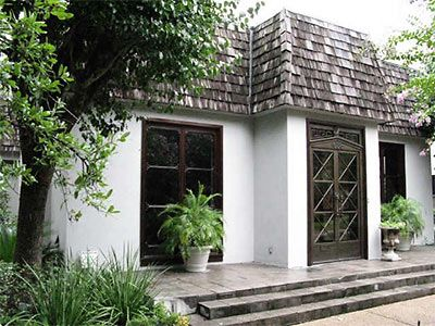 Charming Mansard Roof with dark trim