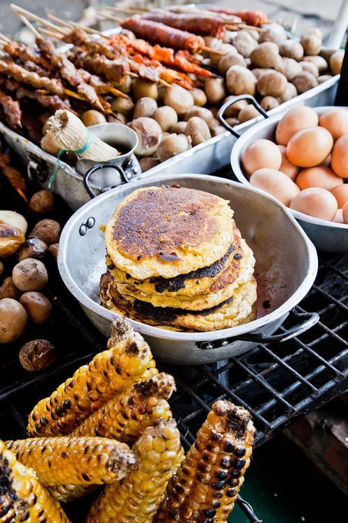 Colombia's street food staples, including arepas and corn on the cob, are served piping hot at Enrique Olaya Herrera National Park   Bogotá