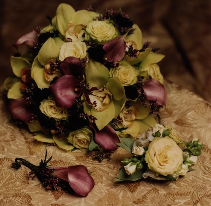 Christopher & Company signature pieces including burgundy mini calla boutonniere, rose corsage and our bride's bouquet of green orchids, burgundy calla, chocolate cosmos, lime green roses, etc. Photo by Judy Eliyas & Studio 925