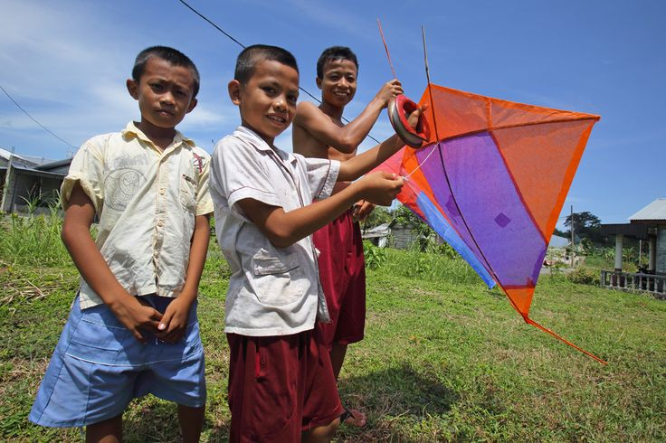 Kids on Nias Island with a home-made kite. Kite flying is a popular hobby for here, as in elsewhere in Indonesia. Photo by Bjorn Svensson. www.visitniasisland.com