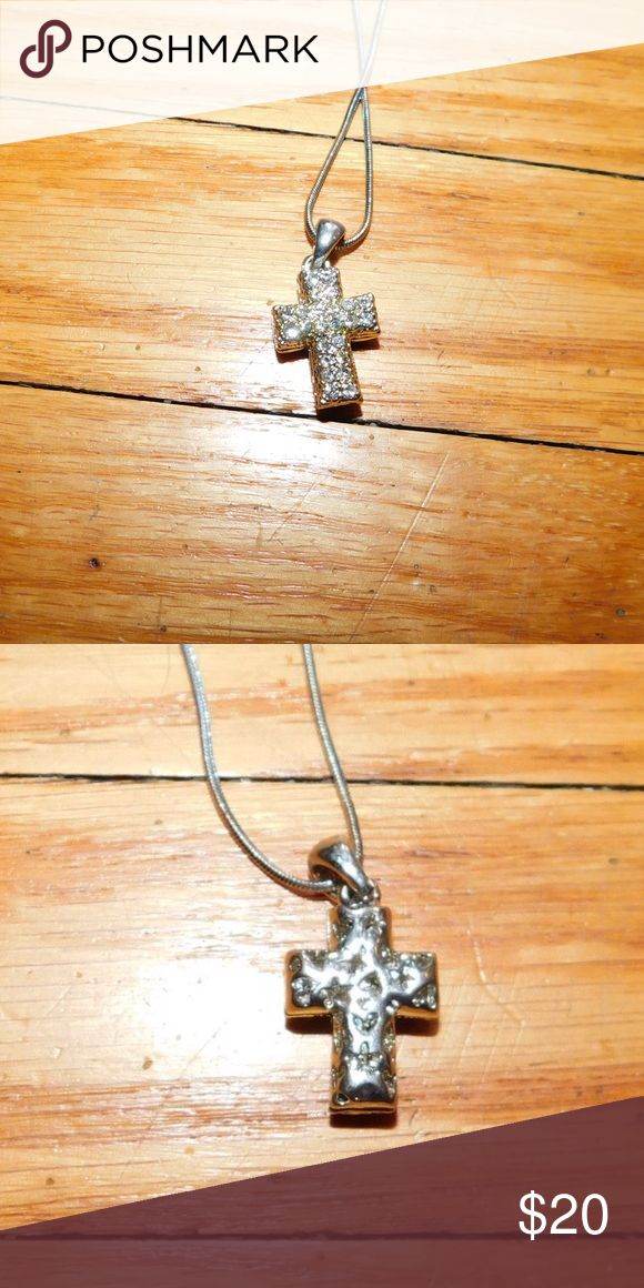 Cross necklace - sterling silver Reversible cross necklace. One side diamonds, the other stars and hearts. Beautiful necklace for a fashion statement or to show off your faith in style!! Jewelry Necklaces