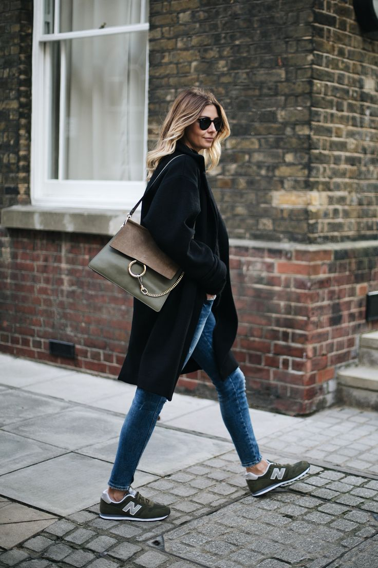 Emma Hill wears black winter coat, ripped skinny jeans, olive 373 New Balance trainers, Khaki Chloe Faye bag, casual winter outfit
