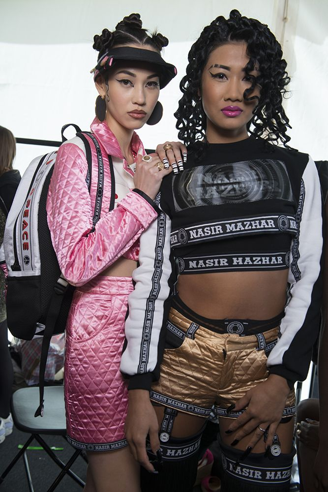 His collections are filled with 'ghetto styling', brash slogans, crop-tops, and acid colours, all of which are loved by his devoted fanbase. #NasirMazhar #LFW #SS14 #Topshopsupport