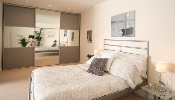 beijing - clear mirror & silver grey panel sliding wardrobe doors in silver grey frame