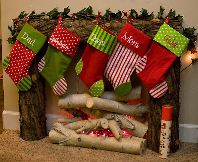 this is adorable?! don't have a fireplace or mantle to hand stockings from?? Build a little temporary one with logs!!! I am so doing this for this year!!!: Stockings, Christmas Fireplaces, Cute Ideas, Faux Fireplaces, House, Christmas Decor, Christmas Ideas, Fire Places, Fake Fireplaces