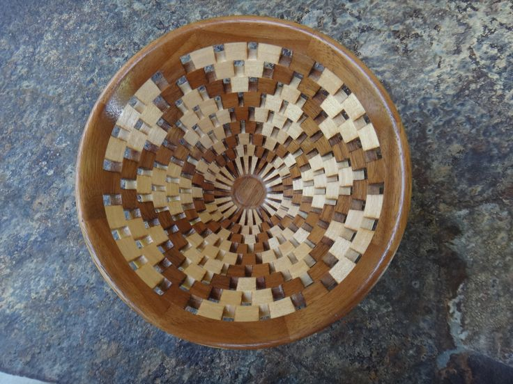 Inside view of open segmented funnel shaped bowl made of maple and walnut