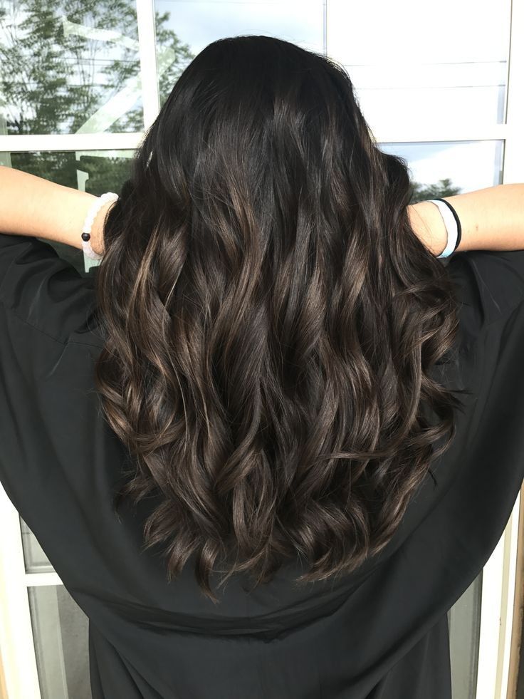 Dark brown hair with subtle peekaboo highlights