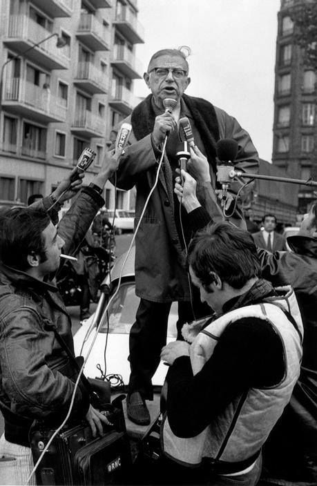 Jean-Paul Sartre talking to the press near to the Renault factory of Boulogne-Billancourt, explaining to students and workers that theirs was a shared struggle with a shared reward, Paris, France, 1970, photograph by Bruno Barbey.
