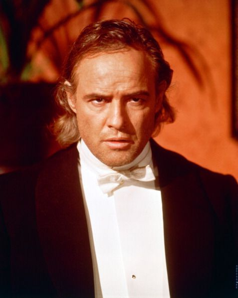 Marlon Brando (1924-2004), US actor, wearing a black jacket, white shirt and white bow tie, with a menacing look on his face, in a publicity portrait issued for the film, 'The Nightcomers', 1971. The horror film, a prequel to Henry James' 'The Turn of the Screw', directed by Michael Winner, starred Brando as 'Peter Quint'.: