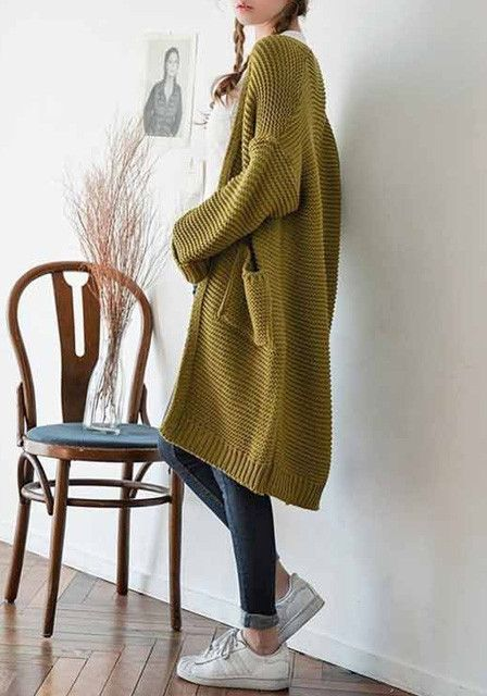 Angled left view of model in open front knit cardigan