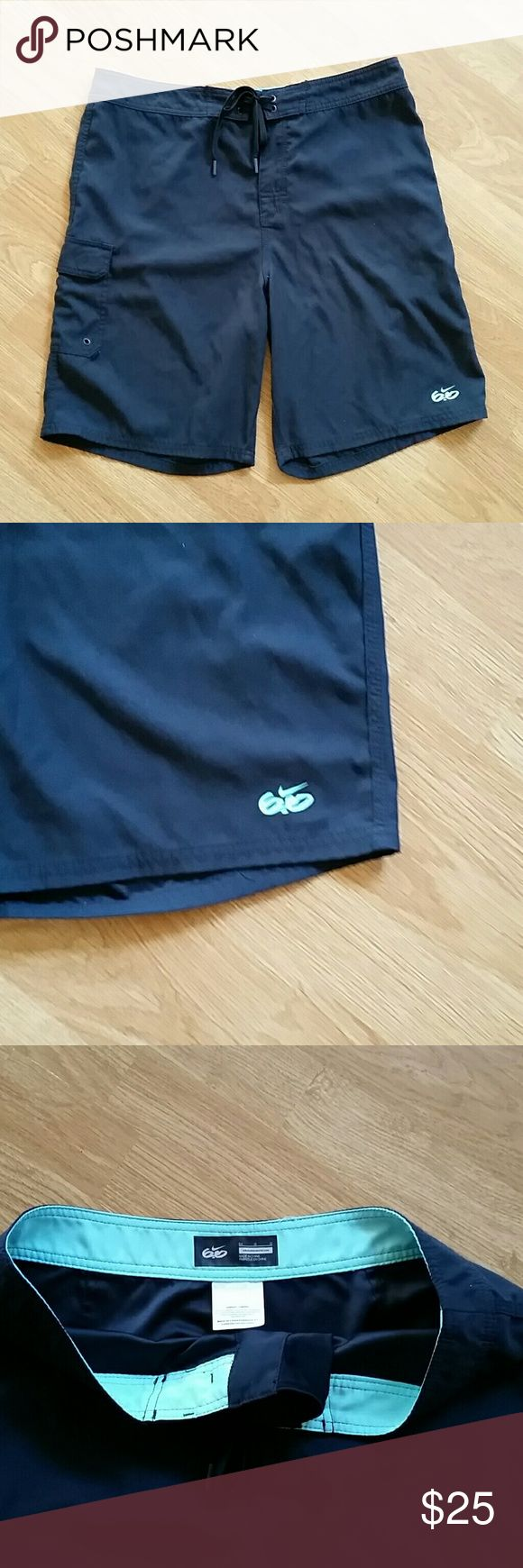 Nike 6.0 Swim Trunks size 34 Black swim trunk with turquoise inside waist and on the 6.0 logo. Side pocket on leg.  Excellent Used Condition Nike Swim Swim Trunks