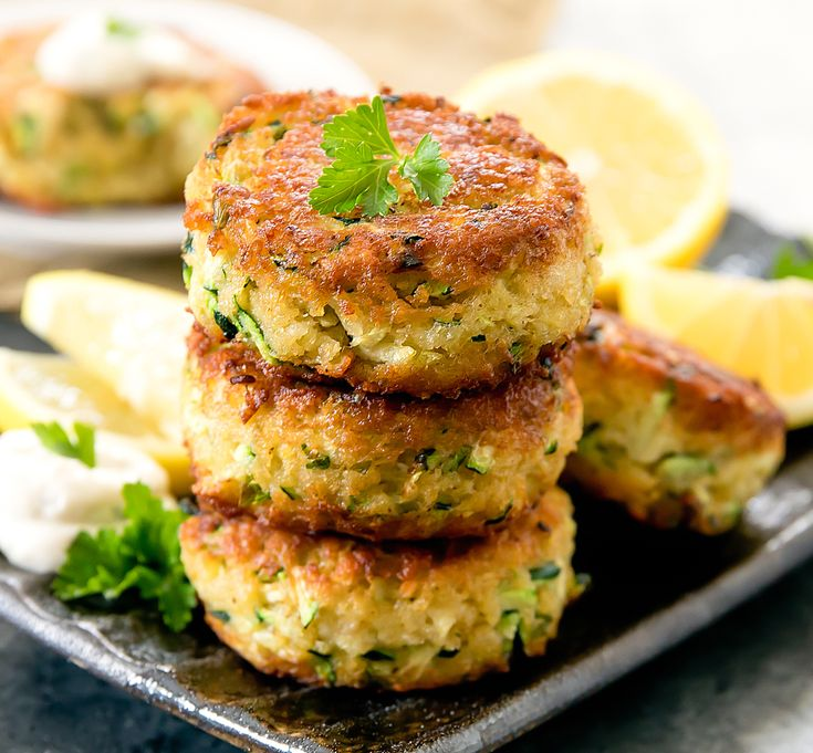 """Zucchini """"Crab"""" Cakes, also known as Poorman's Crab Cakes, are made with zucchini instead of crab. Even though these fritters do not contain any crab meat, they taste like regular crab cakes!"""