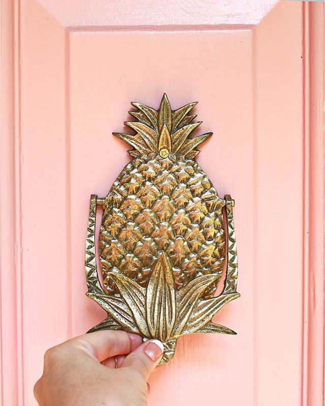 pink door pineapple knocker peach interior home decor