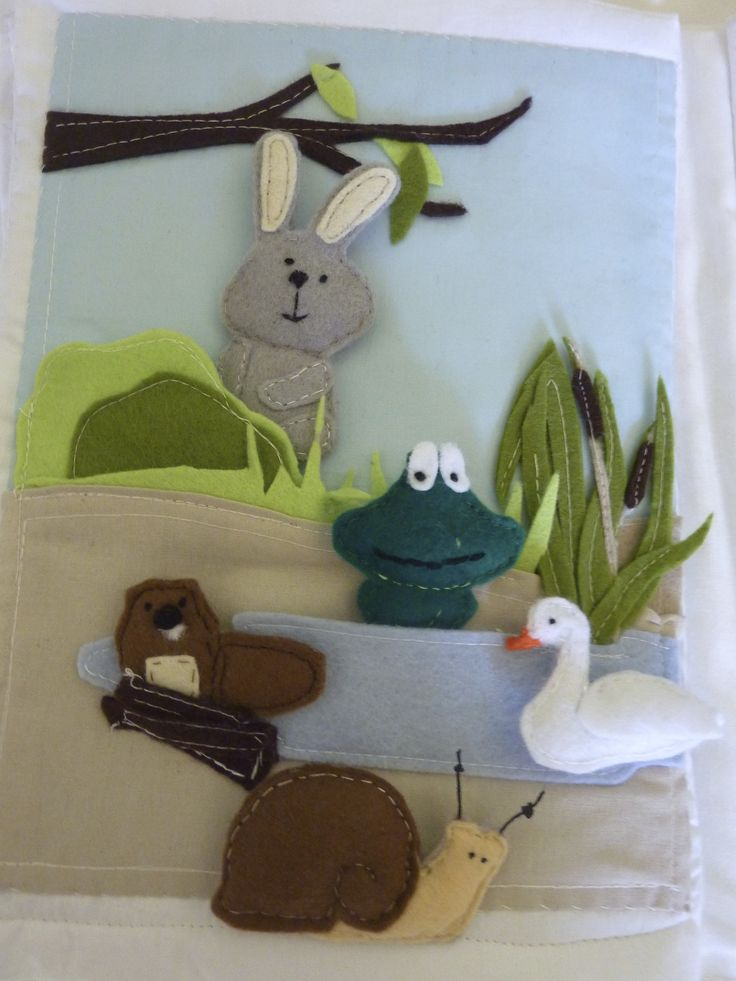 quiet book animals in and around the pond. Bunny,frog,swan a snail and a beaver rat.