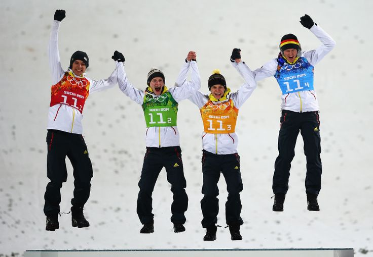 Gold medalists Andreas Wank, Marinus Kraus, Andreas Wellinger and Severin Freund of Germany celebrate during the flower ceremony for the Men's Team Ski Jumping final round (c) Getty Images