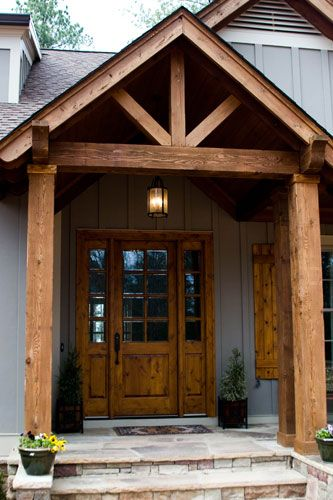Could be a cool smaller scalar of using timbers and have the glass door in there Timber frame entrance