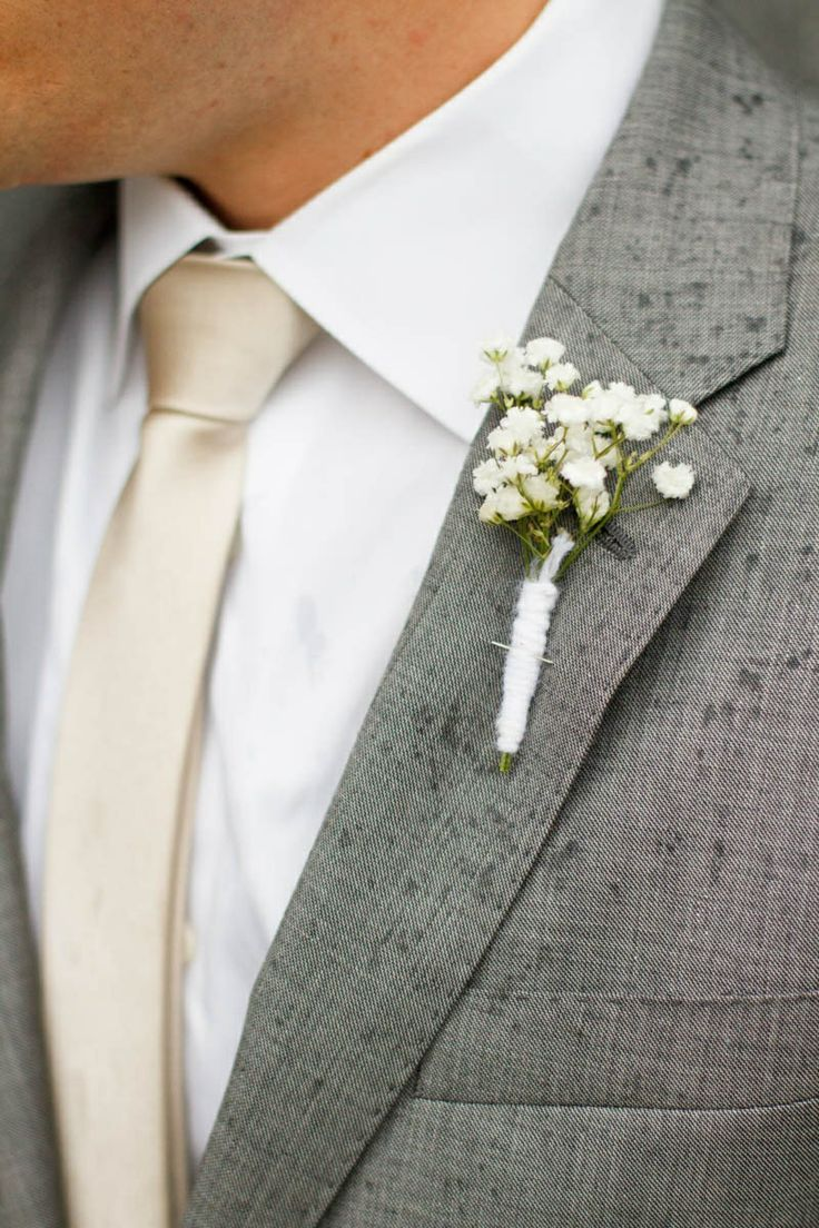 Baby's Breath Boutonniere | Kate Osborne | TheKnot.com    -suit and tie