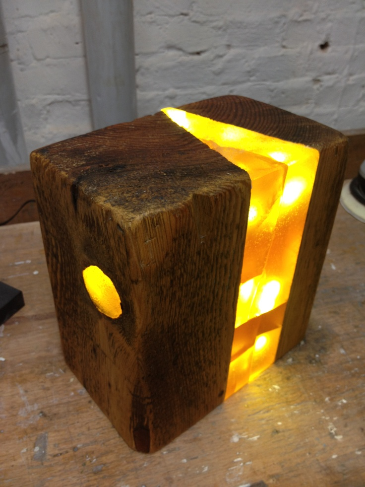 Light sculpture made from old block of wood, with LEDs cast in resin.