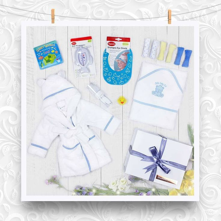 Boys 'Bath Time' gift set is packed full of baby bath time products. White soft bath robe with blue gingham edging, white towel with blue edging, shampoo shield, bath book, bath thermometer, brush and comb set, six wash cloths and that all important baby sized yellow bath duck #babyboy #baby #gifts #newborn #bath