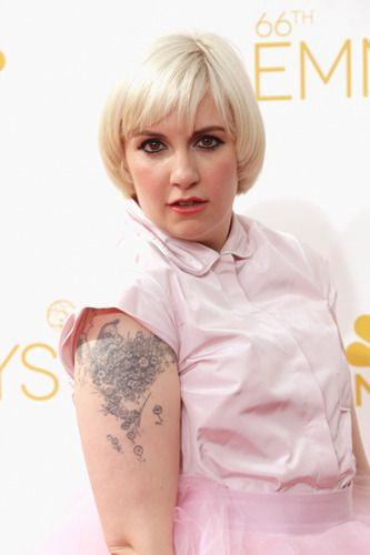 We review Lena Dunham's new memoir Not That Kind Of Girl http://yhoo.it/1sI5HNy