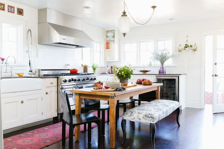 mixing it up in the kitchen, vintage pendant light, mid century black chairs, classic white kitchen