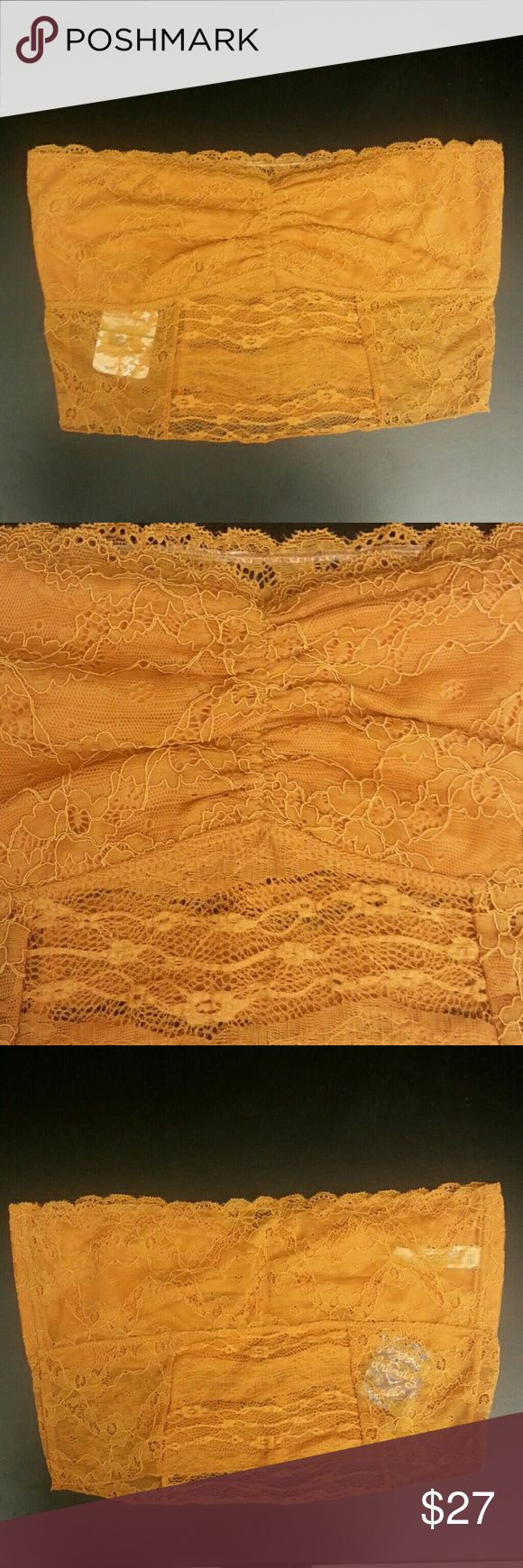 "SALE Free People Lace Bandeau Bra Lace bandeau bra from Intimately Free People. Golden orange-brown color listed as Amber. This measures about 14.75"" at the bust, unstretched. Material is stretchy. Free People Intimates & Sleepwear Bandeaus"