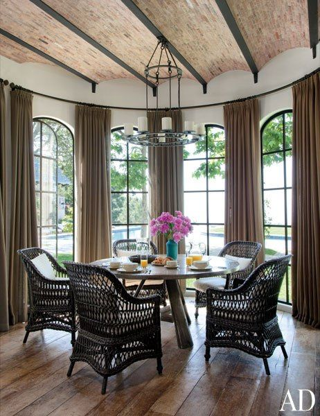 Gisele Bündchen and Tom Brady's Los Angeles Home Breakfast Room A Kevin Reilly light fixture is suspended from the breakfast room's reclaimed-brick ceiling, above a Gregorius | Pineo table and Brenda Antin chairs; the curtains are of a Sahco fabric.