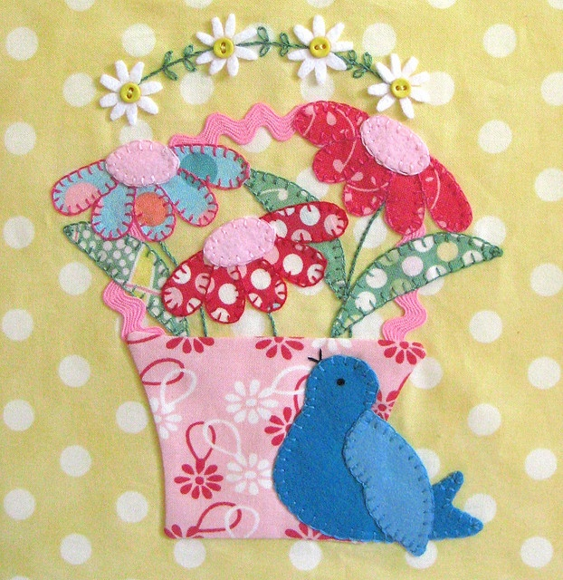 Appliqued bird and flowers
