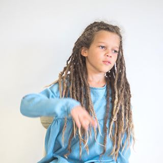 """People keep asking, is it my real hair. Yes it is, 100%. Why do I have dreadlocks? Because I hated to get my hair brushed when I was smaller. As my mom says, my hair is """"no fish, no flesh"""" - meaning that it's not really silky and it's not strong afro either. So I had an uncontrollable stack of ... something called hair with curls in it. #curlyhairtroubles #dreadlocks #nofishnoflesh #okaidi #rastakid"""