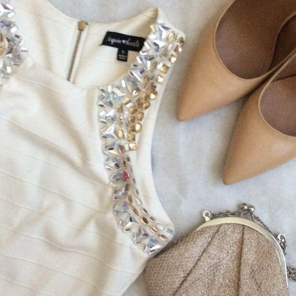 STUNNINGRHINESTONE EMBELLISHED DRESS!! Stunning rhinestone embellished bandage dress!!!! Just into for New Years  (worn once to a ball).                                         Bandage dress 95% polyester 5% spandex Dresses Mini