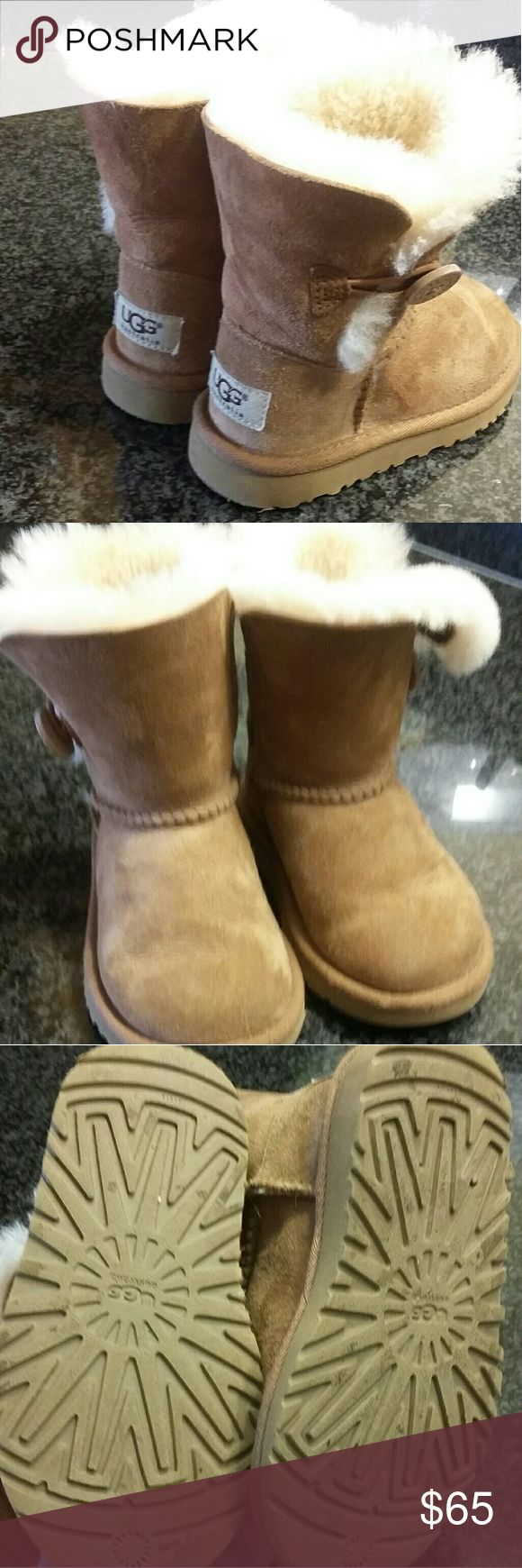Ugg little girls boots Great used condition. This is a size nine in little girls ugg boots. One small spot as shown in last pic. Buttons also show some wear as pictured.minimal wear on toes UGG Shoes Boots