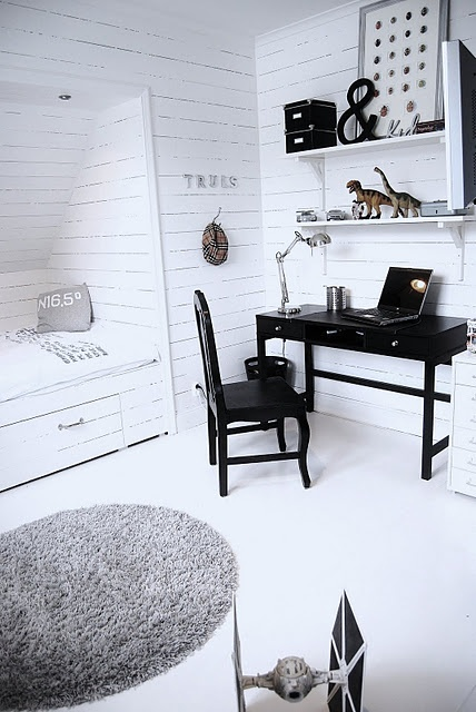 Paint the tiny table black and use for a laptop desk, shelves above it. Find a cool, industrial stool...