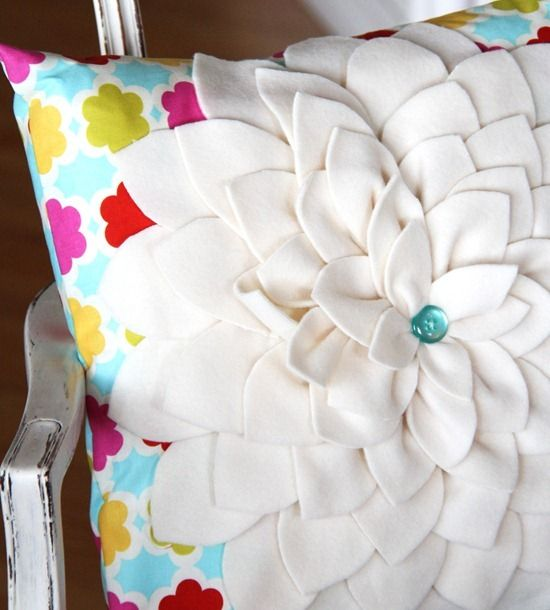 flower out of fleece - I like that better than felt!  Here is the original tutorial from Cluck Cluck SEW - http://www.cluckclucksew.com/2008/09/petal-pillow-tutorial.html