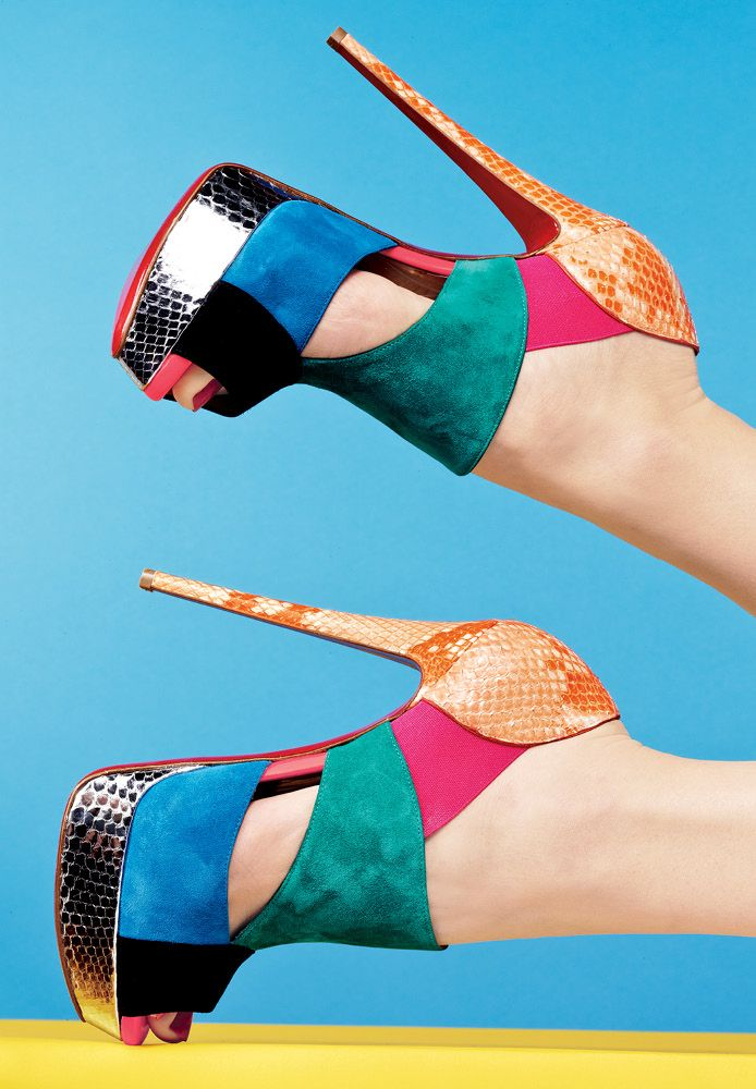 A mélange of colorblocked suede, metallic python and python. #louboutin #platform