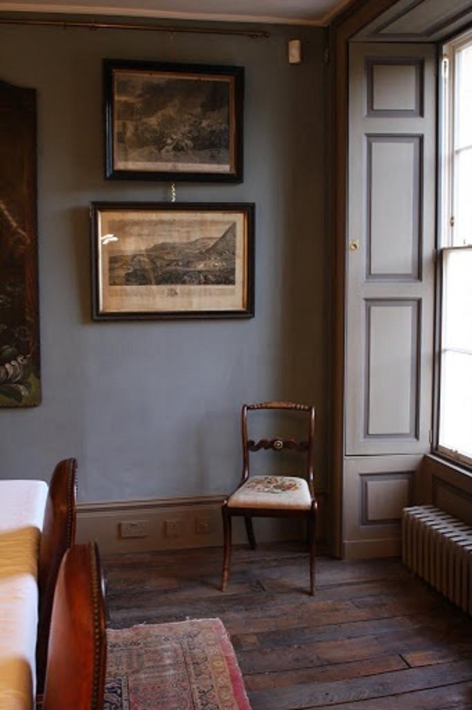 moody gray walls, antique prints, rug